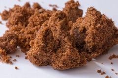 Dark sugar and unrefined sugar cane. Close-up Stock Photo
