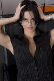 Dark suit woman. Attractive brunette business woman wearing dark suit Royalty Free Stock Photo