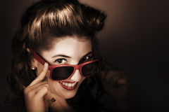Dark summer fashion. pin up woman in sunglasses Stock Images