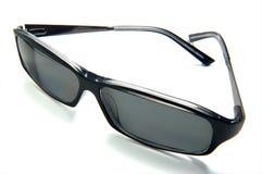 Dark Sunglasses. Brightly lit on white background royalty free stock photo