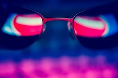 Dark sunglasses with reflection of a prohibiting road sign against a computer keyboard in the dark. The concept of anonymity in the Internet. Hacker activity Royalty Free Stock Photos