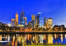 Me Yarra East CBD Dark. Dark sunrise in Melbourne city across waters of Yarra river to waterfront of city CBD when high-rise office towers reflect with bright Royalty Free Stock Image