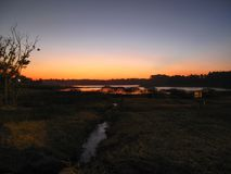 Sunset at city water reservoir. Dark sunset at city water reservoir Royalty Free Stock Image