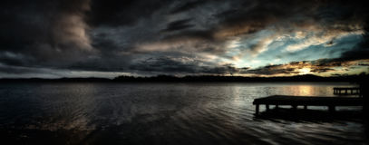 Dark sunset over the lake Royalty Free Stock Image