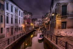 Dark sunset in Venice. Walking over a bridge in a dark sunset royalty free stock images