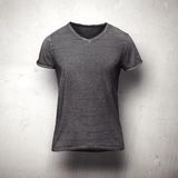 Dark  t-shirt isolated on grey background Royalty Free Stock Photo