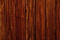 Dark teak wood grain plank background. Dark teak wood grain background Royalty Free Stock Photos