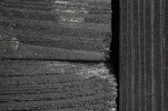 Dark texture of black shine wood. Joint of black wooden boards. Very dark texture of black shine wood Royalty Free Stock Photos