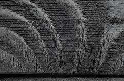 Dark Texture of Black Shine Wood. Black Texture of the Structure of Undulating Wood Fibers. Macro Snapshot of Very Dark Texture of Black Shine Wood Royalty Free Stock Photography
