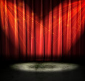 Dark theatre. Red curtains on a stage with sparkly lights Royalty Free Stock Image