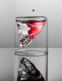 Dark thoughts. Negative with red stains in the glass skull Stock Photo