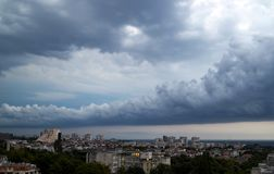 Dark thundercloud in the form of an arc is approaching Varna. It became dark, there will be a downpour soon royalty free stock photography