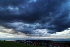 Dark thunderclouds over a small town stock photo