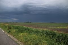 Dark thunderstorm clouds above polder Wilde Veenen in Waddinxveen in the Netherlands.  Stock Photography