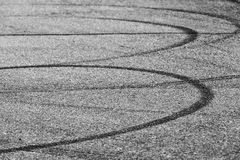 Dark tire tracks on gray asphalt road Royalty Free Stock Photo