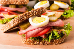 Dark toast sandwich. With pork sausage and eggs Stock Photo