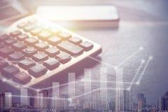 Dark tone of calculator and smart phone royalty free stock photos