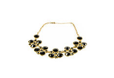 Dark tone gem and gold necklace Royalty Free Stock Photography