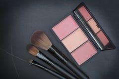 Dark tone selective focus on beautiful peachy cheek blusher kit Royalty Free Stock Photos