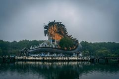 Dark tourism attraction Ho Thuy Tien abandoned waterpark, close to Hue city, Central Vietnam, Southeast Asia. Famous Dragon statue in the middle of the royalty free stock photos
