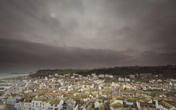 Dark town. English town with dark clouds royalty free stock photo