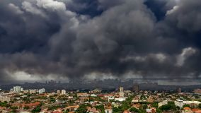 Dark toxic smoke hanging over the city of Durban stock photos