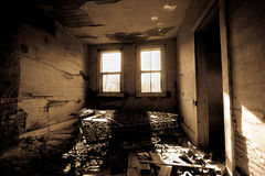 Dark Trashed Room. Abandoned house with a room with trash in it. Bed frame in background Stock Photography