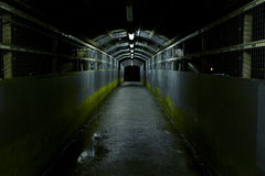 Dark Tunnel. An ominous dark tunnel with partial lighting royalty free stock image