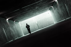 Dark tunnel. Men walking in a dark tunnel Royalty Free Stock Photos