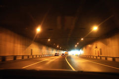 Dark tunnel with cars. And lights Stock Photos