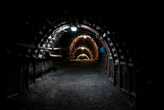Dark tunnel in coal mine Stock Images
