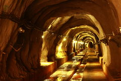 Dark tunnel with light Stock Image