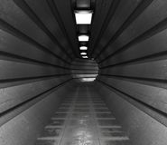 Dark tunnel, a long corridor of round shape lightened with light. Stock Photography