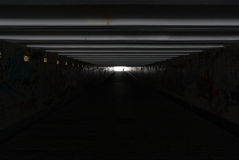 Dark_tunnel. Silhouette of a man in a dark tunnel Royalty Free Stock Photo