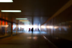 Dark tunnel of underpass. Dark tunnel underpass with silhouettes of people, the light at the end of the tunnel Stock Photo