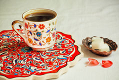 Dark turkish coffee on table with patterned tray Stock Photo