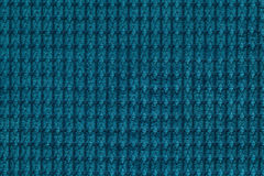 Dark turquoise background from soft fleecy fabric close up. Texture of textiles macro Royalty Free Stock Photos