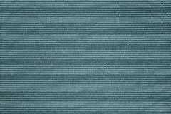 Dark turquoise of fabric with speckled texture Stock Images