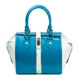 Dark turquoise glossy female handbag isolated on white background. Royalty Free Stock Photo