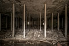 Dark underground space in abandoned factory royalty free stock image