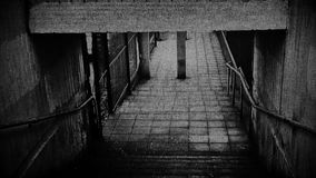 Dark Underpass. Walking down steps through an underpass with added digital noise and flickering stock footage
