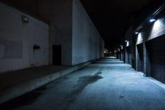 Dark urban city alley at night. Dark and eerie urban city alley at night royalty free stock photos