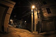 Dark Urban City Alley at Night. Dark industrial urban city alley at night royalty free stock images