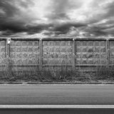 Dark urban road with concrete fence Royalty Free Stock Image