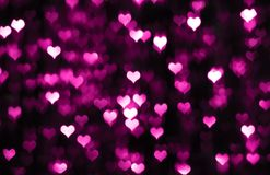 Dark valentine background with purple hearts Stock Photo