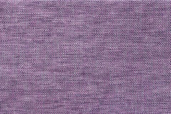 Dark violet background of dense woven bagging fabric, closeup. Structure of the textile macro. Stock Photo