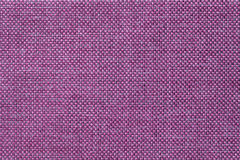 Dark violet background of dense woven bagging fabric, closeup. Structure of the textile macro. Stock Image