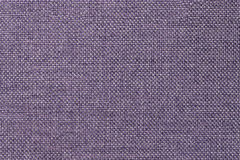 Dark violet background of dense woven bagging fabric, closeup. Structure of the textile macro. Stock Photos