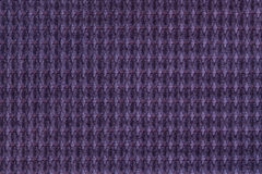 Dark violet background from soft fleecy fabric close up. Texture of textiles macro Royalty Free Stock Image