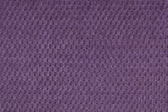 Dark violet background from soft fleecy fabric closeup. Texture of textile macro Royalty Free Stock Image